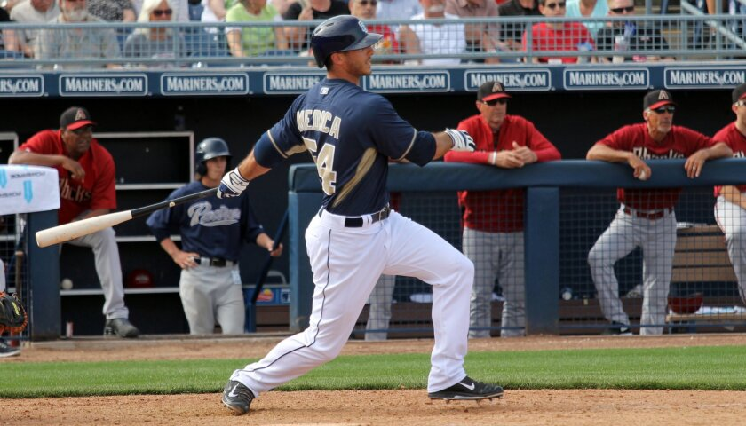 Padres first baseman Tommy Medica bats against the D-backs during a spring training game in Peoria, Ariz.
