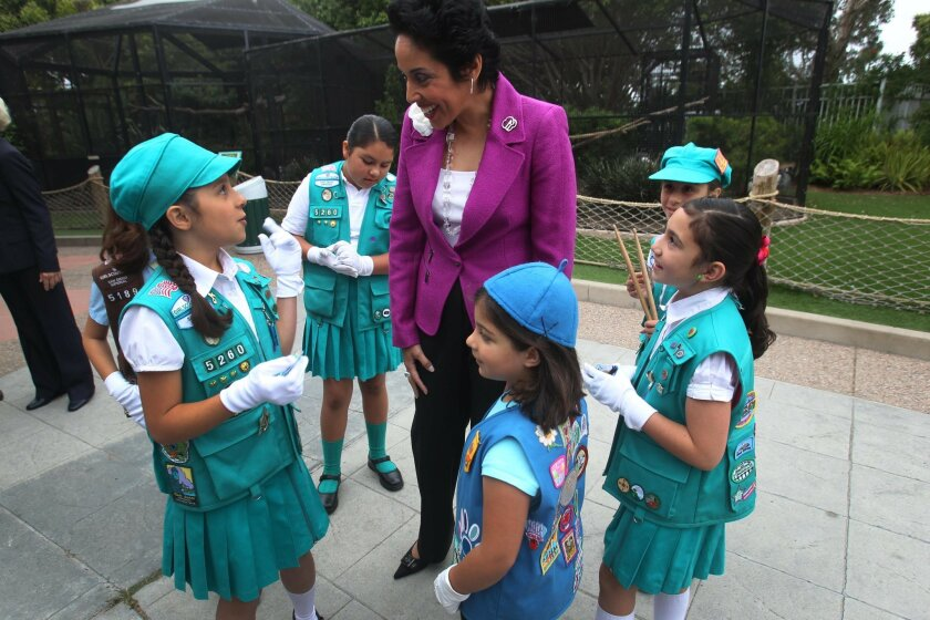 Anna Maria Chavez, the new CEO for Girl Scouts of the USA, talked with Girl Scouts from Rancho del Rey troops 5260 and 5189 before the start of the program.  The girls are, from right to left, Melanie Kellis, 10, Lisamaria Ruiz, nine years-old, Emma Persichilli, a Daisy, five years-old, Nicole Kell