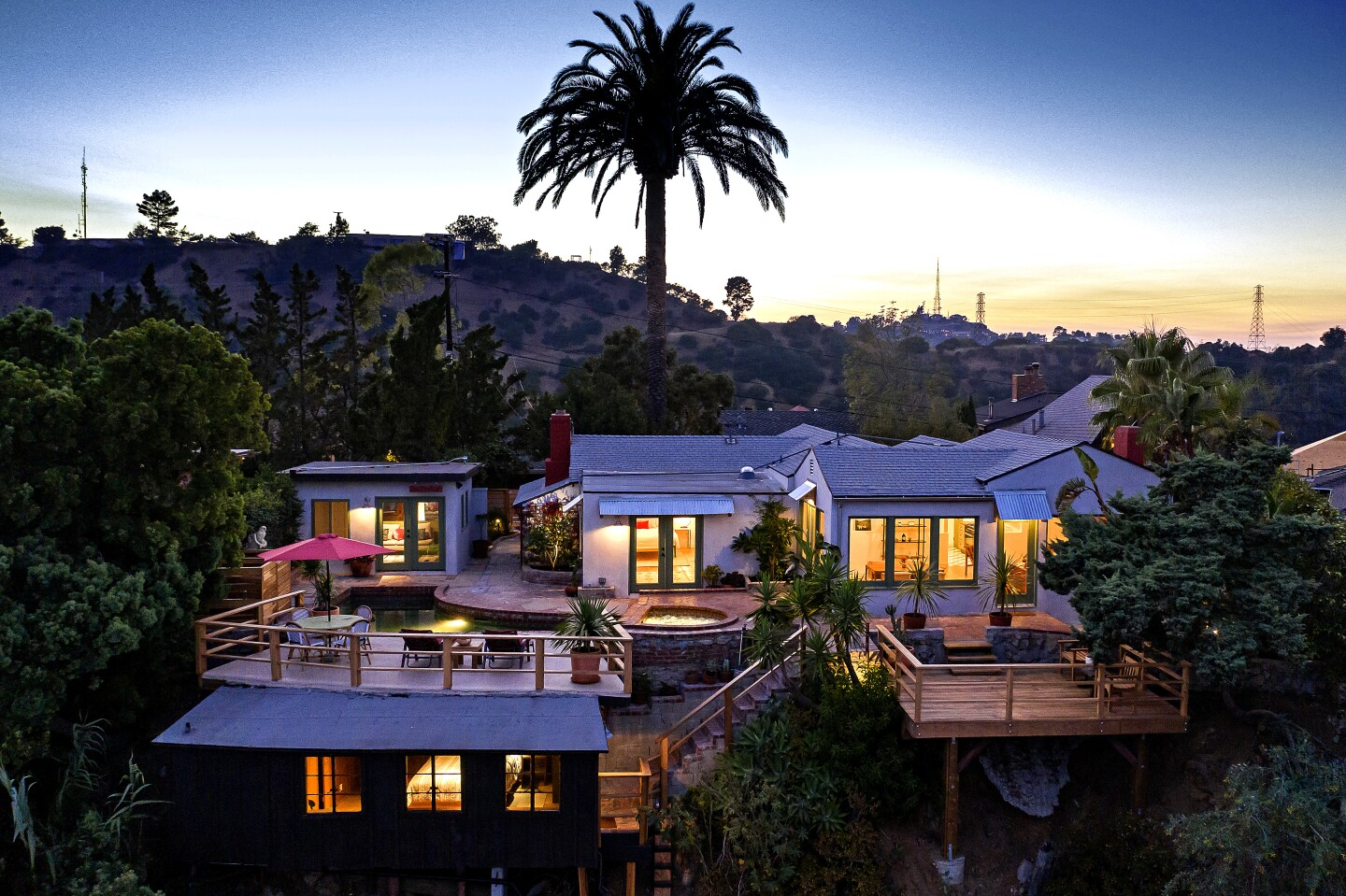 Married actors and serial home-flippers Corbin Bernsen and Amanda Pays have listed their latest project, a four-structure compound in Laurel Canyon, for $1.995 million. The properties were originally part of a small real estate empire owned by actor-producer Beach Dickerson, who leased the homes to various Hollywood types, including Bernsen. A main house, a pool house, an A-frame-style guesthouse and a small bungalow combine to offer four bedroom and four bathrooms.