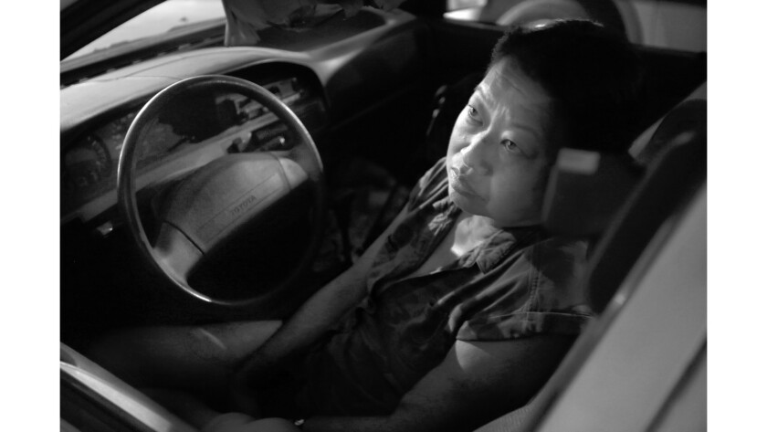 Meg Shimatsu, 54, spends her nights in her car parked outside the hospital where she gets dialysis treatment.