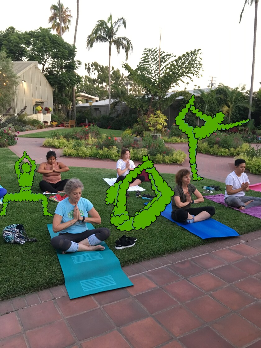 People practice yoga at the Sherman Library & Gardens in Corona del Mar.
