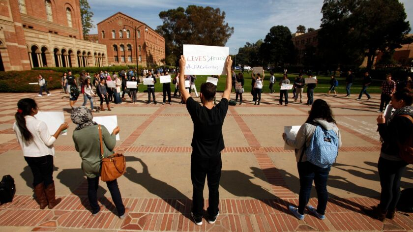 Students stand in front of UCLA's Royce Hall on March 5, 2014, to protest a university decision not to divest from companies that conduct business with Israel.