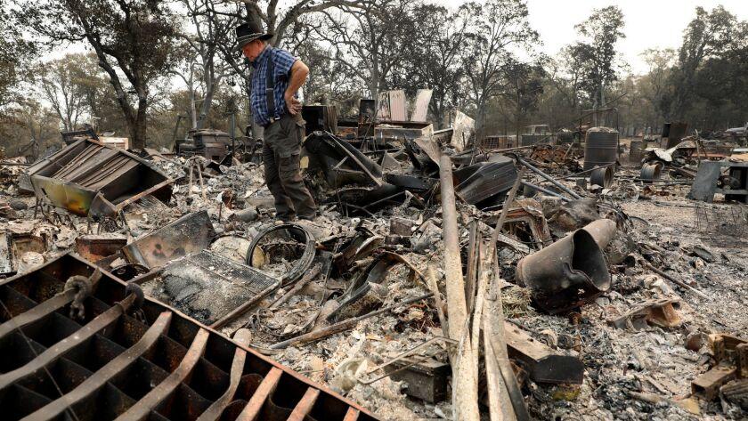 REDDING, CALIF. -- SATURDAY, AUGUST 4, 2018: Ed Bledsoe, 76, surveys his home and belongings damaged