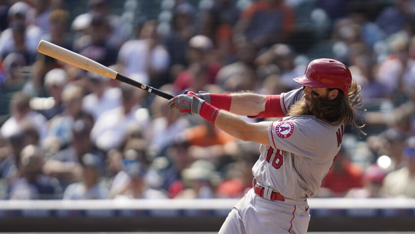 Brandon Marsh of the Angels hits a two-run triple against the Detroit Tigers.