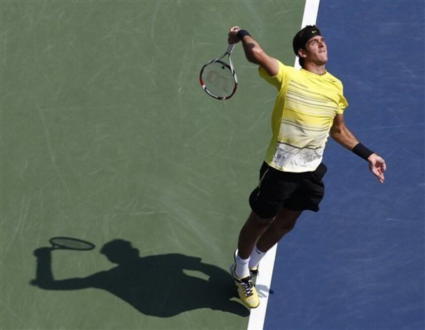 Juan Martin Del Potro of Argentina serves to Diego Junqueira of Argentina during the U.S. Open tennis tournament in New York, Friday, Sept. 2, 2011. (AP Photo/Paul J. Bereswill)