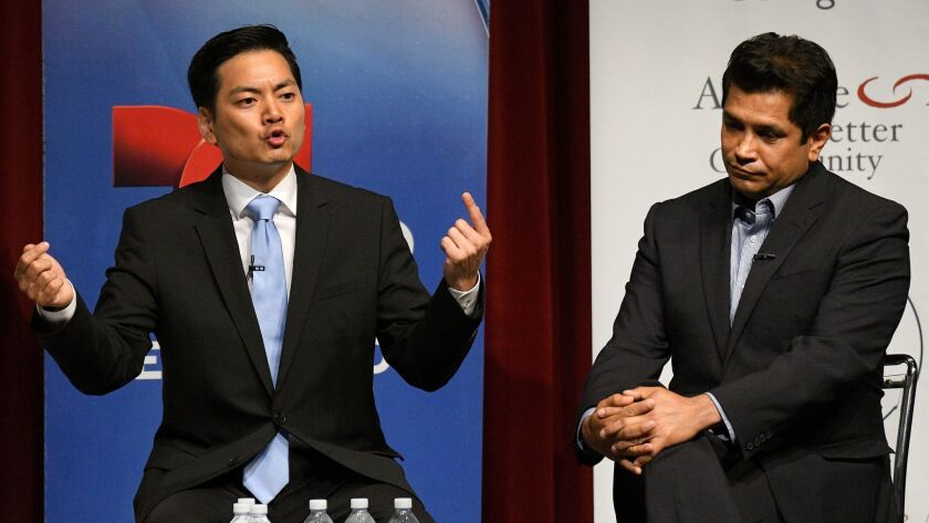 Robert Lee Ahn, left, and Assemblyman Jimmy Gomez, both Democrats, at their only debate on May 25 at Occidental College.