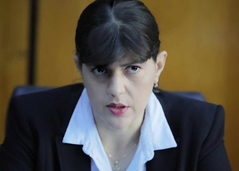 In this photo taken on Friday, Oct. 4, 2019, Laura Codruta Kovesi, Romania's former chief anti-corruption prosecutor who will direct the European Public Prosecutor's Office (EPPO) - tasked with investigating fraud connected to the use of EU funds and other financial crimes, speaks during an interview with the Associated Press, in Bucharest, Romania. For Kovesi, opposition to her successful candidacy to become the European Union's first chief prosecutor came from a familiar source - her own country's government. Kovesi spent five years as head of the Romanian Anticorruption Directorate and those indicted by her office included 14 Cabinet members, 53 lawmakers and a member of the European Parliament. (AP Photo/Vadim Ghirda)