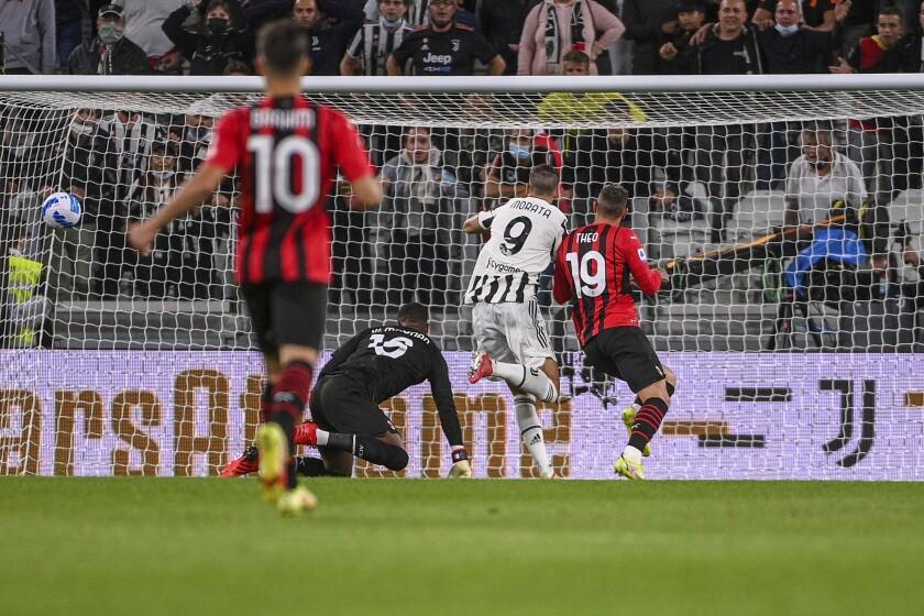 Juventus' Alvaro Morata scores his side's opening goal during the Serie A soccer match between Juventus and AC Milan, at the Turin Allianz stadium, Italy, Sunday, Sept. 19, 2021. (Marco Alpozzi/LaPresse via AP)