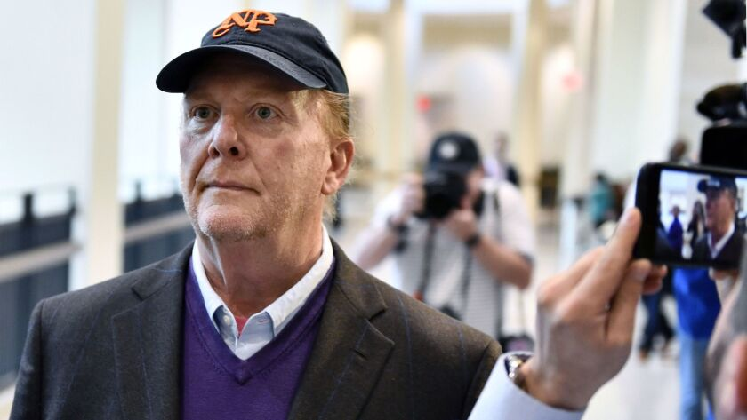 Chef Mario Batali arrives for arraignment, Friday, May 24, 2019, at municipal court in Boston, on ch