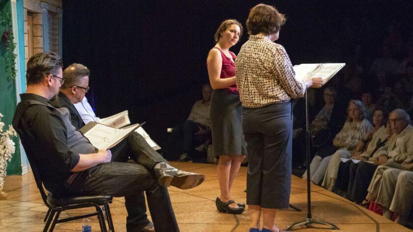 "Actors Richard Baird, left, Richard Trujillo, Larry Baza, hidden, Melba Novoa and Catalina Maynard, right, perform H. Lee Sarokin's play ""The Protester"" at North Coast Repertory Theatre Monday night."