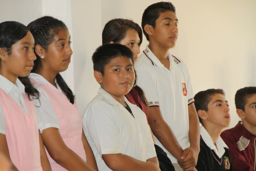 Young U.S. citizens enrolled in  Tijuana's Secondary School Number 10 attend a ceremony launching a pilot program to help them make the transition to Mexican public school.