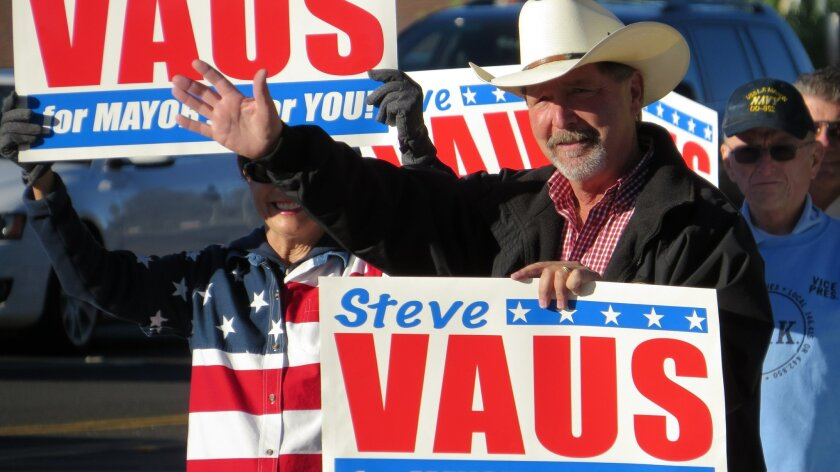 Steve Vaus and supporters do some last minute campaigning at the intersection of Twin Peaks and Community roads in Poway on Tuesday morning.