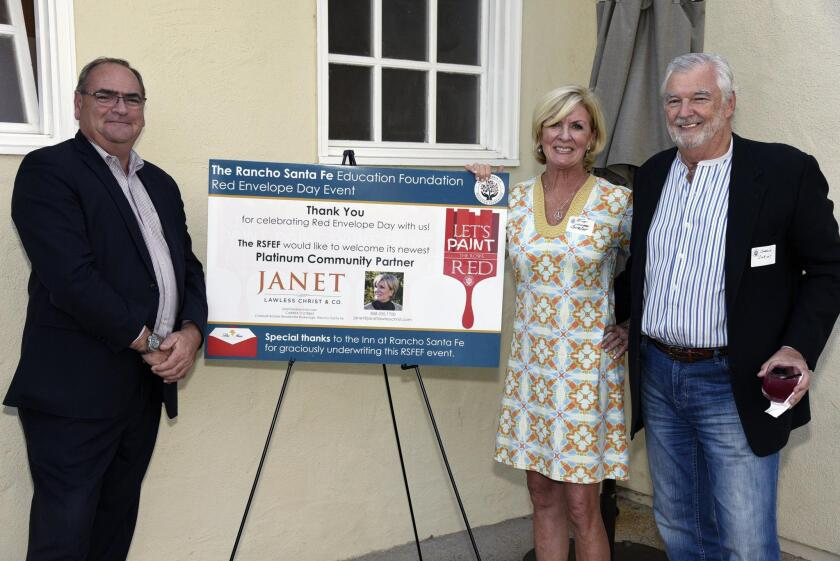 General Manager Jerome Strack of event co-sponsor Inn at Rancho Santa Fe, co-sponsor Janet Lawless Christ and Charlie Christ