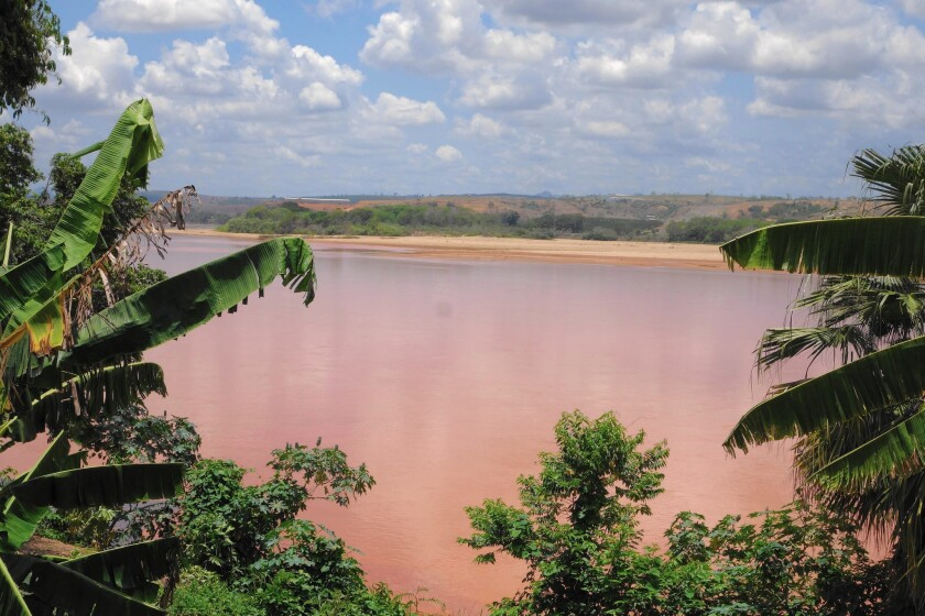 A mining waste spill has turned Brazil's Rio Doce a bright orange for a 300-mile stretch.