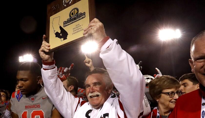 CERRITOS, CALIF. .. - NOV. 23, 2018. Mater Dei head coach Bruce Rollinsonholds up tghe CIF Champion