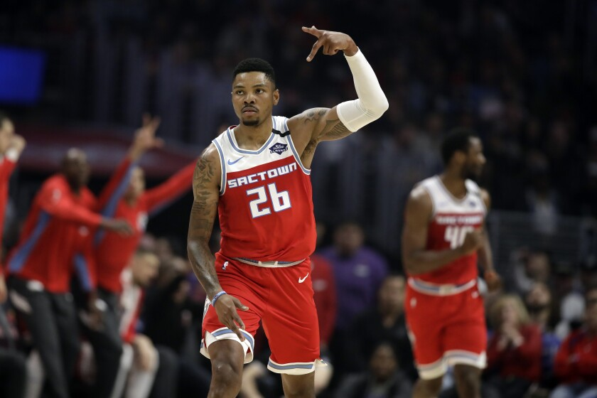Kings guard Kent Bazemore reacts after scoring against the Clippers during the first half of a game on Feb. 22, 2020.