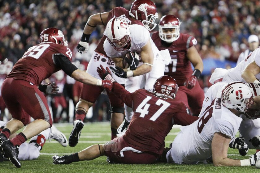 Stanford running back Christian McCaffrey, center, runs against Washington State linebacker Peyton Pelluer (47) and linebacker Parker Henry (29) during the second half of an NCAA college football game, Saturday, Oct. 31, 2015, in Pullman, Wash. Stanford won 30-28. (AP Photo/Young Kwak)29d\