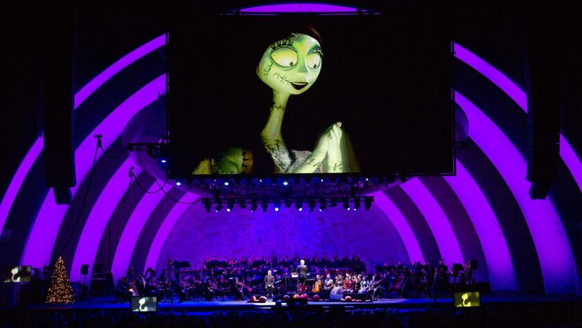 """LOS ANGELES, CA - OCTOBER 31, 2015: Screens show the movie """"Nightmare Before Christmas"""" during Danny"""