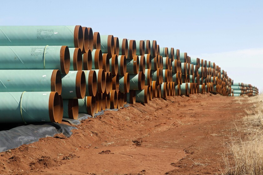 Miles of pipe ready to become part of the Keystone Pipeline are stacked in a field near Cushing, Okla. on Feb. 1, 2012.