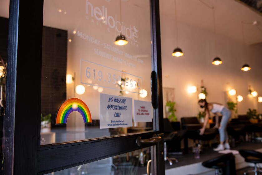 A rainbow decal is posted on the front door of Hello Birdie Nail & Lash Lab in North Park Wednesday.