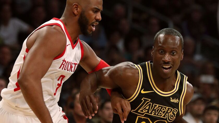 LOS ANGELES, CALIF. - APR. 10, 2018. Lakers guard Andre Ingram drives to the lane against Rockets g