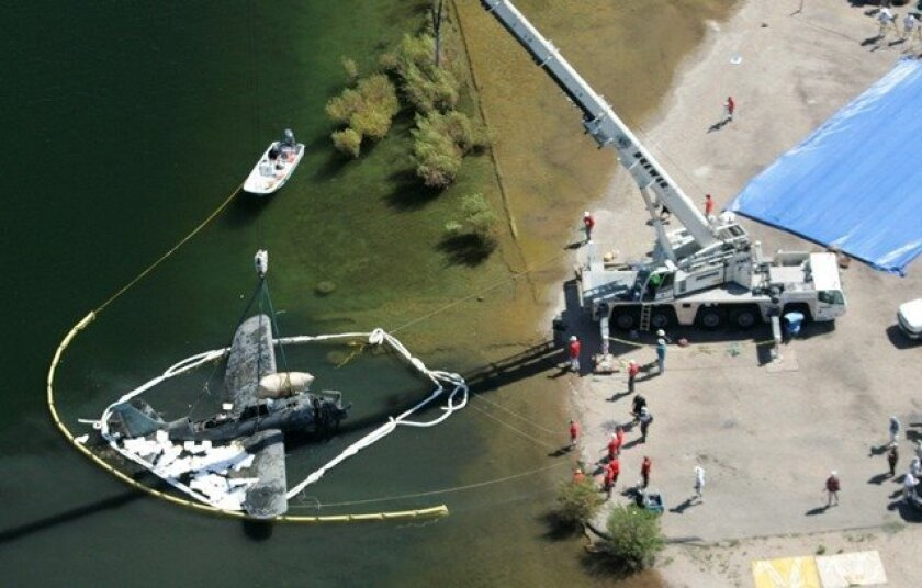 Salvors have successfully raised a navy Helldiver aircraft that crashed into Lower Otay Reservoir in 1945.