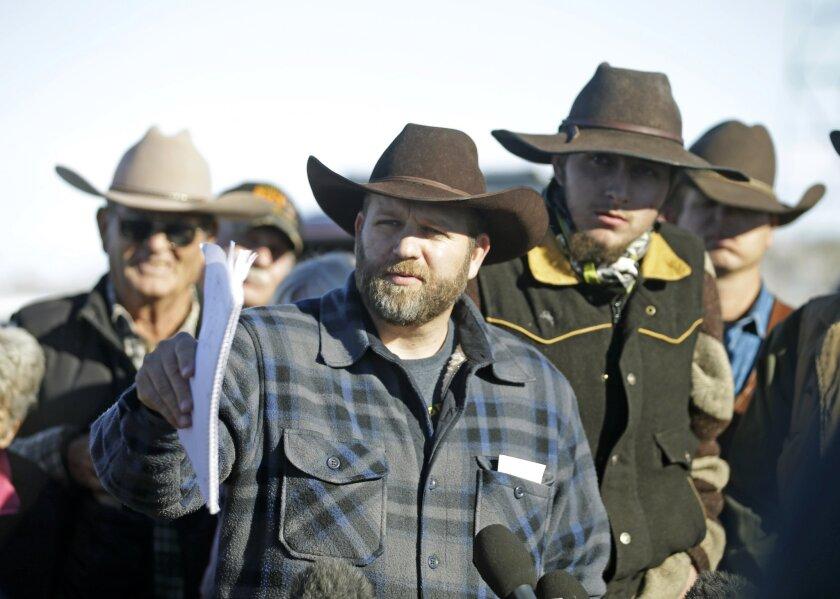 Ammon Bundy, center, at a news conference at Malheur National Wildlife Refuge on Jan. 8.