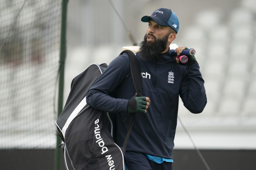 England's Moeen Ali arrives for a nets session before the 5th Test cricket match between England and India at Old Trafford cricket ground in Manchester, England, Thursday, Sept. 9, 2021. (AP Photo/Jon Super)