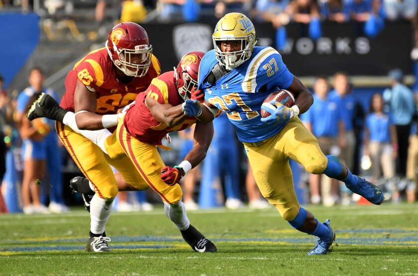 UCLA running Joshua Kelley picks up yards during the Bruins' win over USC last year.