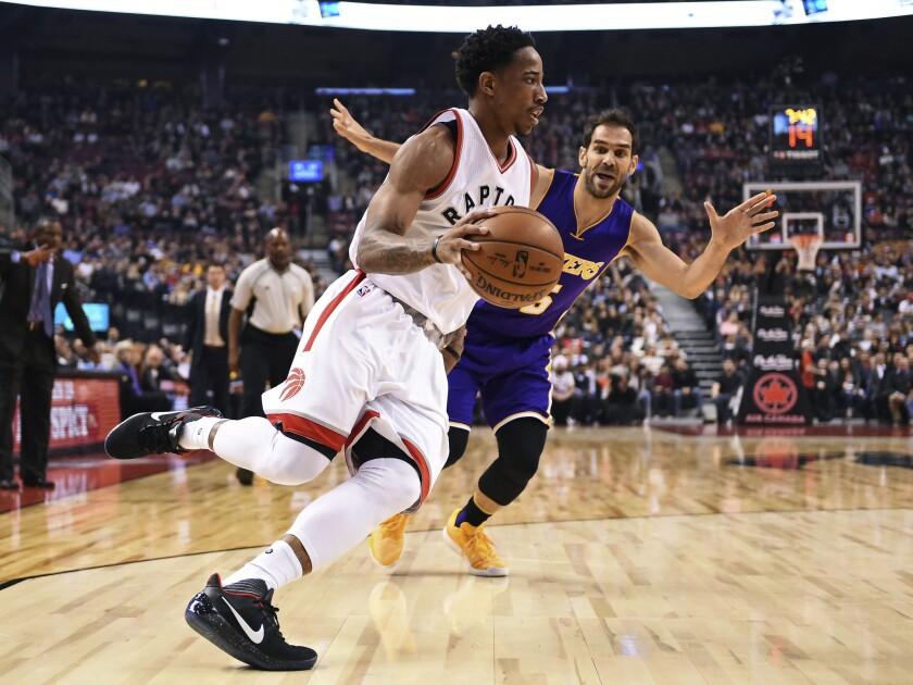 Raptors guard DeMar DeRozan drives past Lakers point guard Jose Calderon during the first half of Saturday's game.