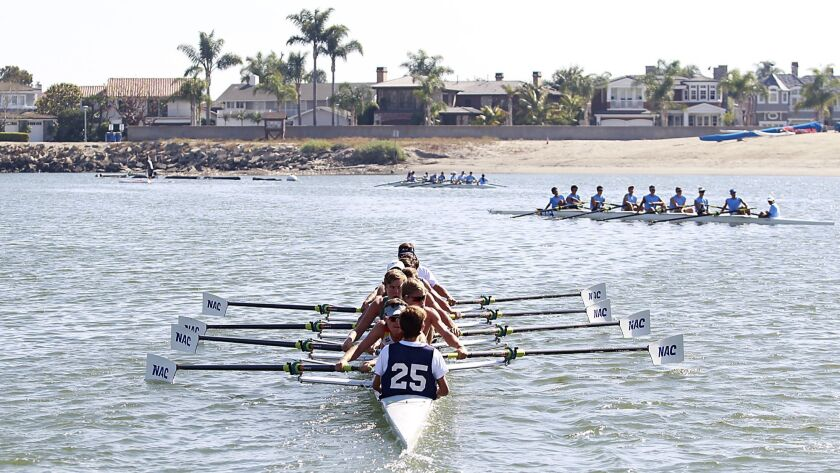 High school crew teams compete at Newport Aquatic Center. The California Coastal Commission rejected a bid by the city of Newport Beach to take over permitting jurisdiction of the facility.