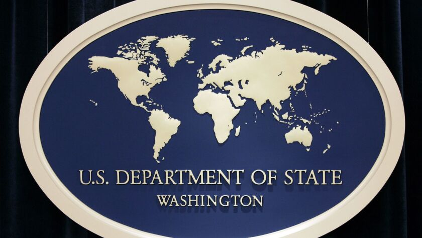 FILE - In this Aug. 10, 2006, file photo, the State Department sign used as a backdrop at the State
