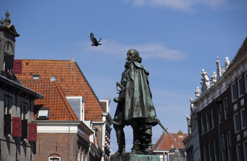 """A statue of the Dutch Golden Age trader and brutal colonialist Jan Pieterszoon Coen stands tall above a square in his hometown of Hoorn, north of Amsterdam, Netherlands, Friday, June 19, 20202. Coen was a leading figure in 17th-century trading powerhouse the Dutch East India Company, but has gone down in history as the """"butcher of Banda,"""" the man who ordered a bloody massacre on the Banda Islands, Indonesia. (AP Photo/Peter Dejong)"""