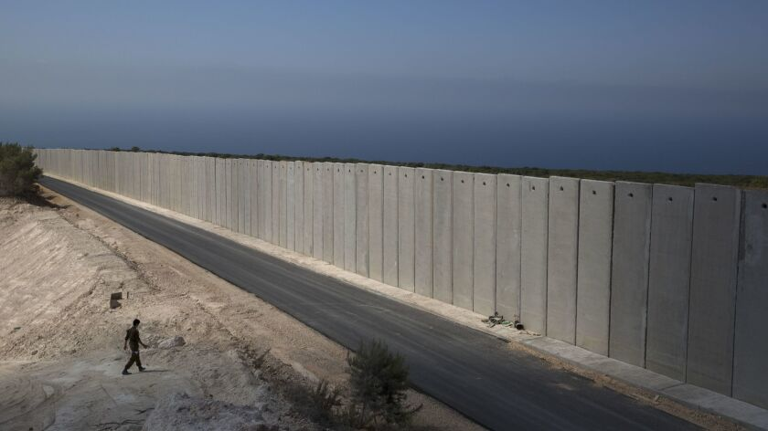 FILE - In this Sept. 5, 2018 file photo, an Israeli soldier stands near a wall at the Israel Lebanon
