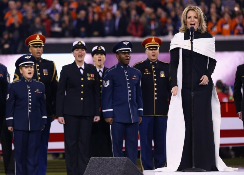 Renee Fleming sings the national anthem during Super Bowl XLVIII at MetLife Stadium in New Jersey.