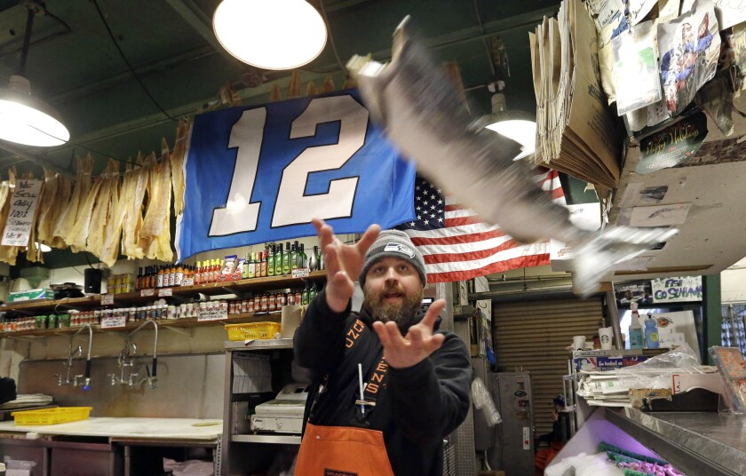 Traditional fish-tossing at Seattle's Pike Place Market: no sign of a slowdown yet because of the minimum wage increase.