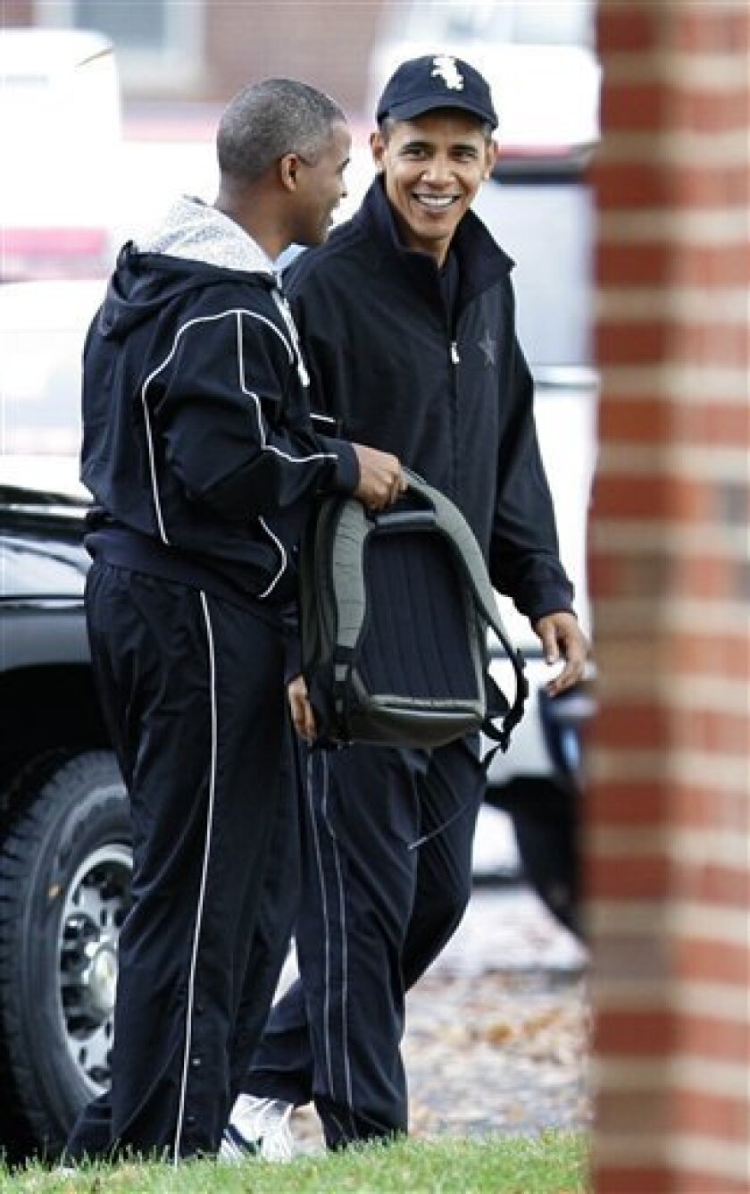 President Barack Obama, right, talks with an Marty Nesbitt as he arrives at Ft. McNair in Washington, to play basketball, Saturday, Oct. 31, 2009. (AP Photo/Susan Walsh)