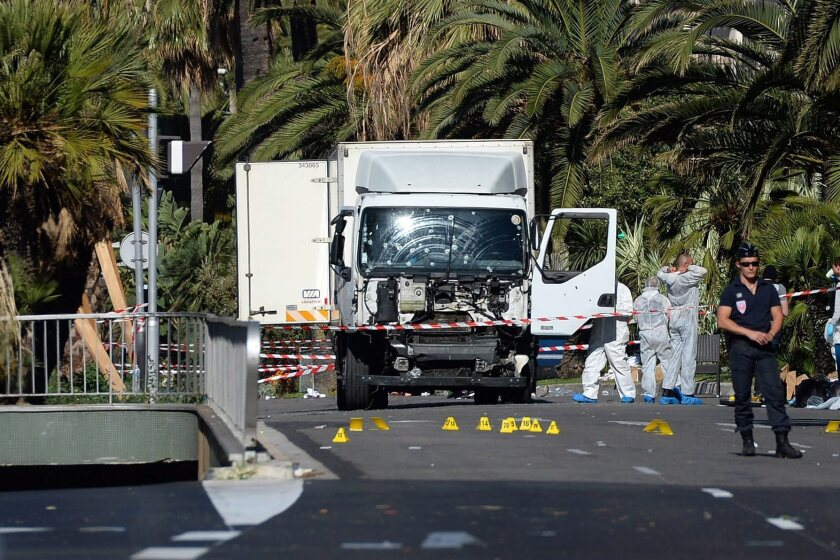 Police secure the area where a truck drove into a crowd during Bastille Day celebrations in Nice, France, killing scores of people.