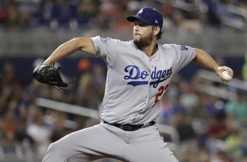 Dodgers starter Clayton Kershaw throws during the fourth inning of the team's victory over the Miami Marlins on Wednesday.