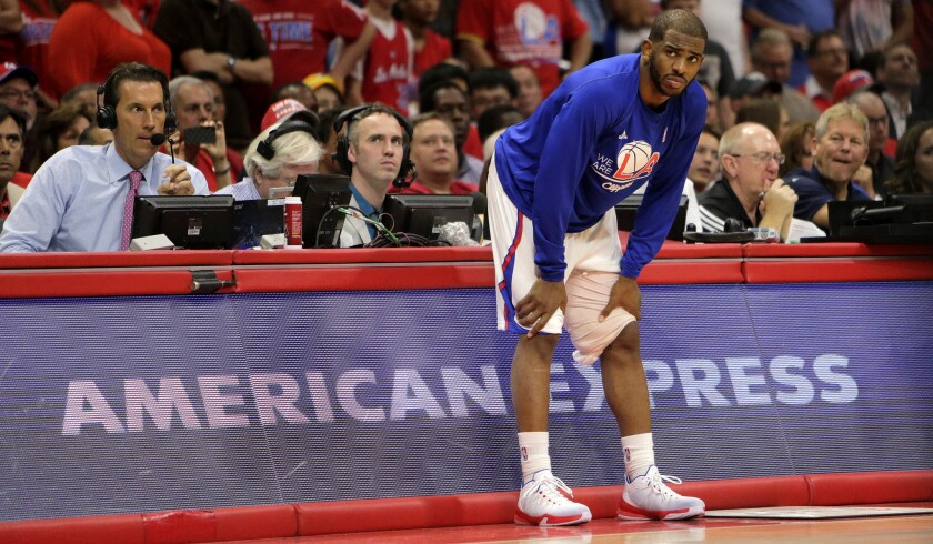 Clippers point guard Chris Paul prepares to go back into Game 7 after injuring his left hamstring. The injury, though, has prevented him from playing in the second-round series against Houston.