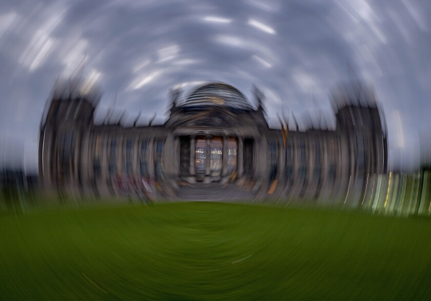 Picture taken while turning the camera shows the Reichstag building with the German parliament in Berlin, Germany, Sunday, Sept. 26, 2021. German elections are held on Sunday. (AP Photo/Michael Probst)