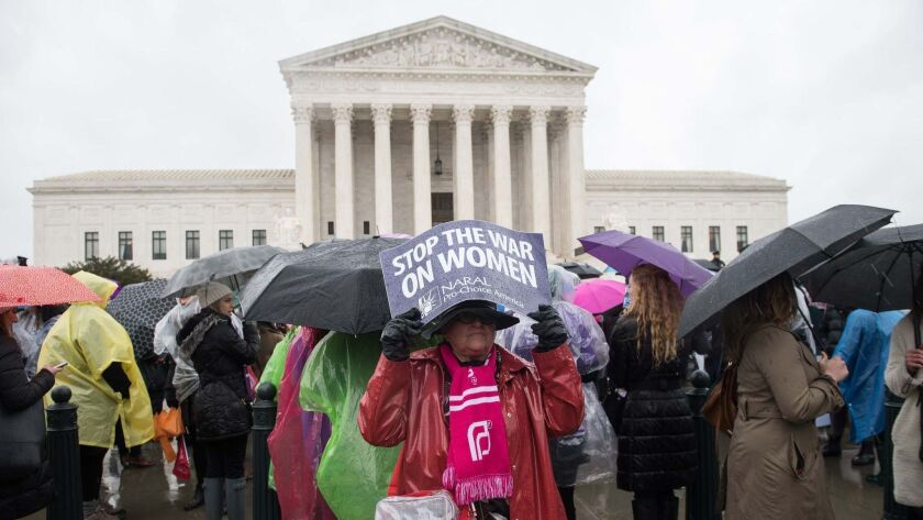An activist demonstrates in front of the Supreme Court in Washington.