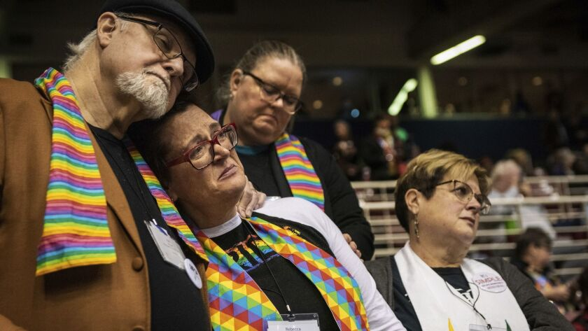 Ed Rowe, left, Rebecca Wilson, Robin Hager and Jill Zundel react to the defeat of a proposal that would allow LGBT clergy and same-sex marriage within the United Methodist Church at the denomination's 2019 Special Session of the General Conference in St. Louis on Tuesday.