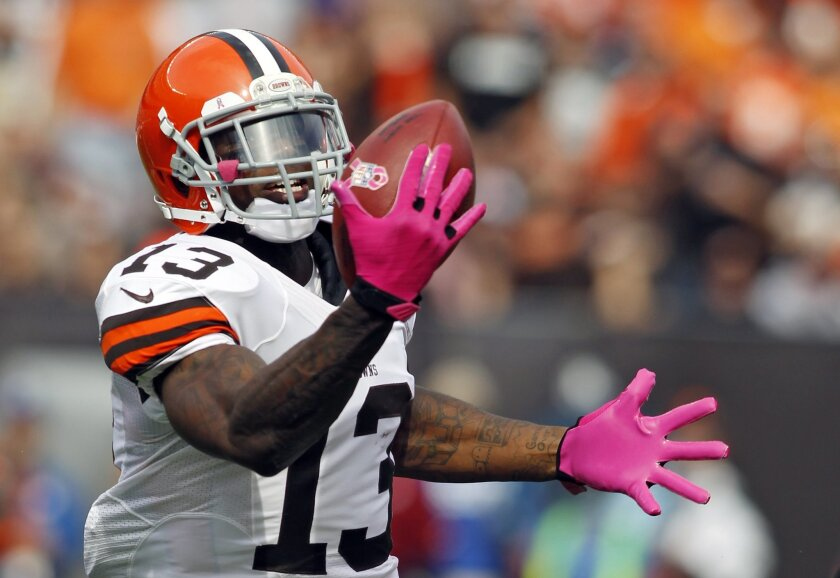 FILE - In this Oct. 14, 2012, file photo, Cleveland Browns wide receiver Josh Gordon makes a one-handed catch on a 71-yard touchdown reception in the second quarter of an NFL football game against the Cincinnati Bengals in Cleveland. Gordon is stepping on the field for the first time in 2014 follow