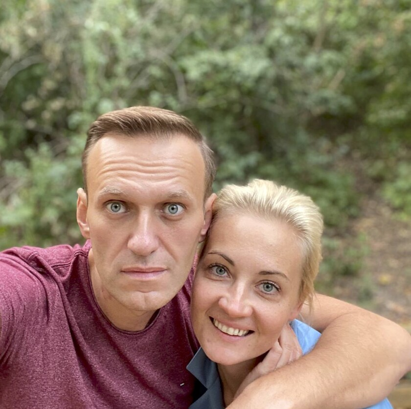 """In this photo published by Russian opposition leader Alexei Navalny on his instagram account on Friday, Sept. 25, 2020, Russian opposition leader Alexei Navalny and his wife Yulia pose for a selfie in an unknown location in Germany. This week Navalny was discharged from a Berlin hospital after being treated for what German authorities determined to be nerve agent poisoning. In an Instagram post on Friday, the politician thanked Russian pilots for landing the plane after he collapsed into a coma on Aug. 20 and medics at the Omsk airport injecting him with atropine, saying they gave him """"additional 15-20 hours of life."""" (Navalny Instagram via AP)"""