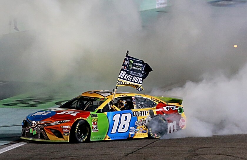 Kyle Busch celebrates with a burnout after winning the NASCAR Cup season title Sunday.