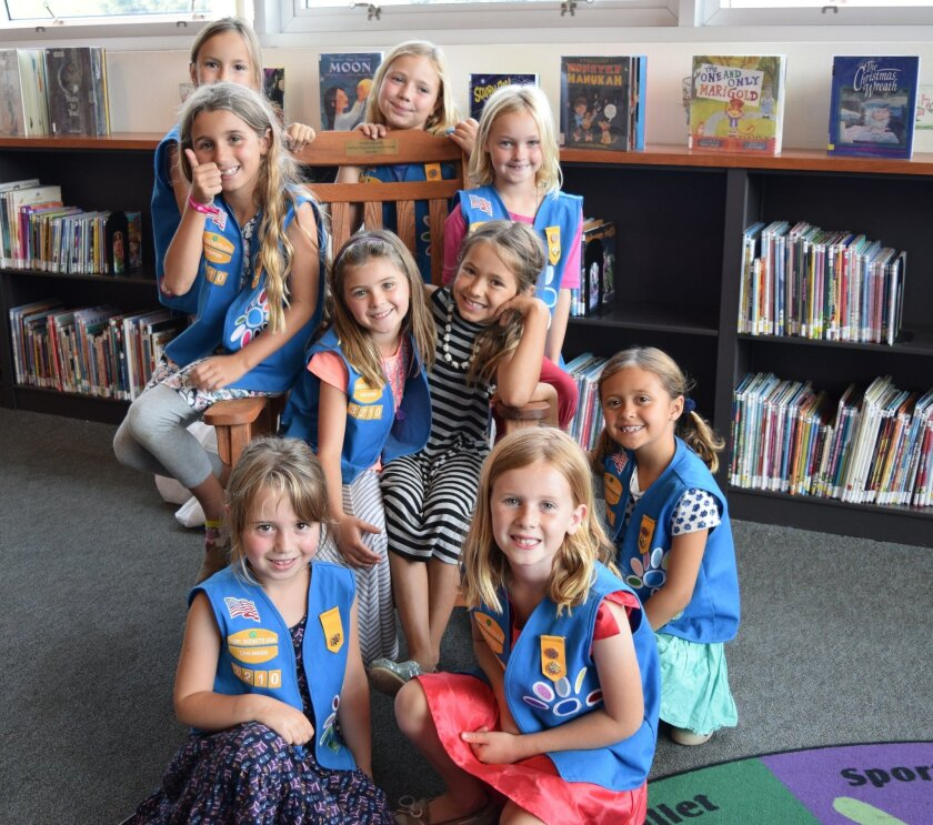 Solana Beach-based Girl Scout Troop 3210 donated a brand-new rocking chair to the library. Volunteers from nonprofit Love on a Leash also donated funds for the chair.