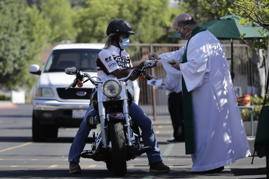 St. Bernardine of Siena Church in Woodland Hills offers drive-through communion prior to outdoor Sunday services.
