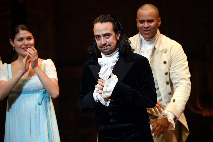 """Actor and """"Hamilton"""" creator Lin-Manuel Miranda, center, takes his final performance curtain call at the Richard Rogers Theatre on Saturday, July 9, 2016, in New York. (Photo by Evan Agostini/Invision/AP)"""