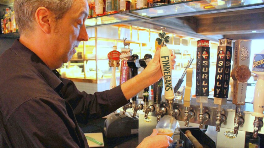 Michael Tombers pours Finnegans Irish Amber Ale at FireLake Grill House & Cocktail Bar at Radisson Blu at the Mall of America in Minneapolis.